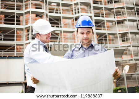 Architect explaining a drawing to the foreman
