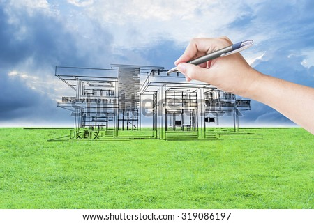 architect hand drawing a house on the grass field and sky background ストックフォト ©
