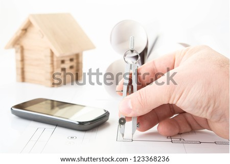 architect hand with tool and smartphone