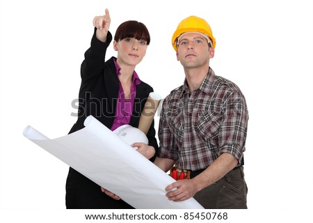 Architect holding plans - stock photo