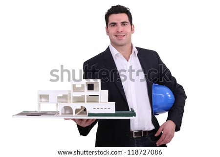 Architect holding replica model of building