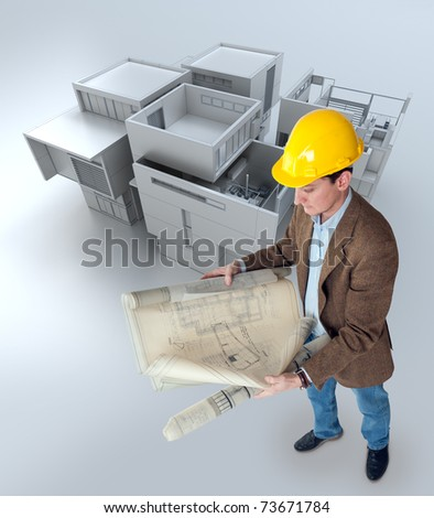 Architect looking at his plans with a building mockup