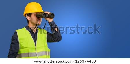 Architect Man Looking Through Binoculars On Blue Background