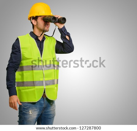 Architect Man Looking Through Binoculars On Grey Background #127287800