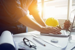 architect man working with laptop and blueprints,engineer inspection in workplace for architectural plan,sketching a construction project ,selective focus,Business concept vintage color