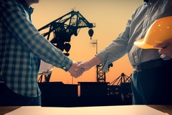 Architect men making handshake in construction site. Employee or worker shake hands to employer man for greeting, dealing, teamwork, collaboration some project or business. They are good team