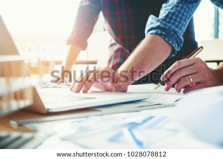 Architect or engineer meeting in office on blueprint And model building. Architects workplace #1028078812