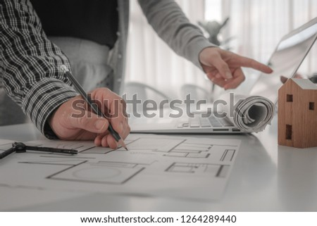 Architect or engineer working in office, Construction, teamwork concept. Engineering tools Architects working with drawing sketch project plan blueprint. Corporate Achievement Planning Design Draw