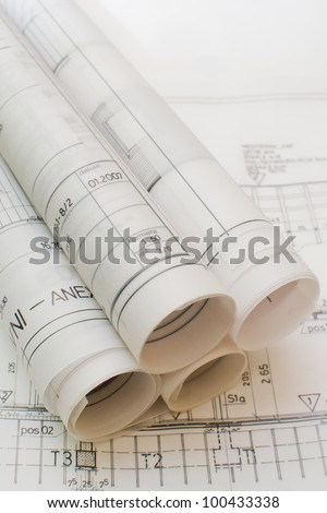 Architect rolls and plans.architectural plan,technical project drawing,Architecture planning of interiors design on paper,construction plan ,close up on constructions blueprints,architectural desk