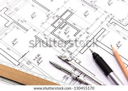 Architect's workspace with plans and tools