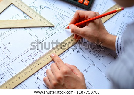 Architect sketching a construction project, view from the top . Architectural blueprints  #1187753707