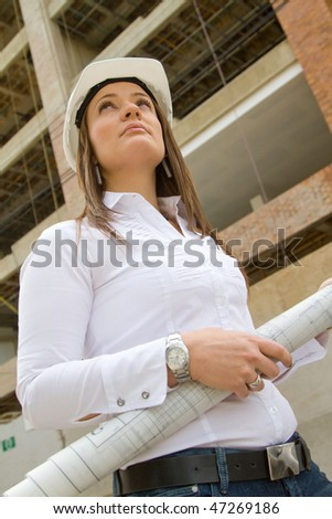 Architect with blueprints at a construction site