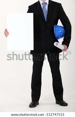 Architect with plans and blank message board