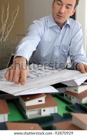 Architect with plans and  model