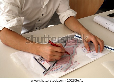 Architect working on a sketch in his studio