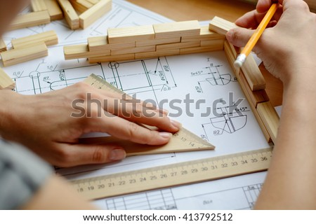 Architect working on blueprint. Architects workplace - architectural project, blueprints, ruler. Construction concept. Engineering tools.