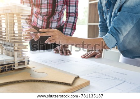 Architect working on blueprint, Engineer meeting working with partner colleagues and engineering tools for architectural project, Construction concept. #731135137