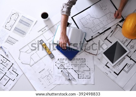 Architect working with blueprints #392498833