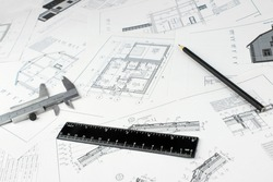 Architect workplace top view. Architectural project, blueprints and Engineering tools. Construction concept. Engineering tools. Copy space.