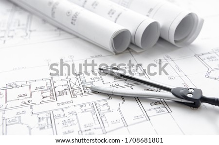 Architect workplace top view. Architectural project, blueprints, blueprint rolls on table. Construction background. Engineering tools. Copy space