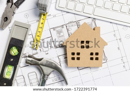 Architect workplace top view. Architectural project, blueprints, blueprint rolls on table. Construction background. Engineering tools. Copy space Stockfoto ©
