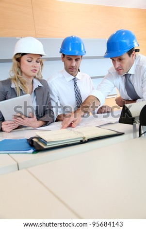 Architects and businesswomen working on construction project