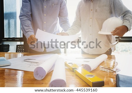 Architects concept, Architects working with blueprints in the office #445539160