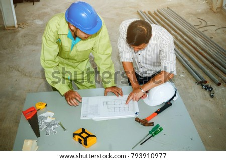Free photos engineer supervisor and staff are checking the building architects in the construction site architects and consultants consult a blueprint top view architects malvernweather Image collections
