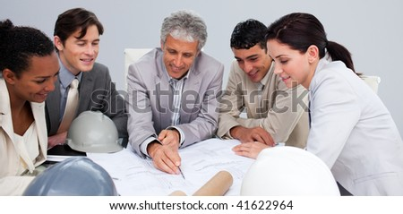 Architects studying plans in a meeting