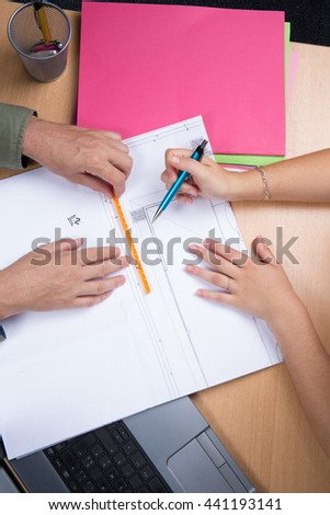 Architects working on plans at business boardroom table #441193141
