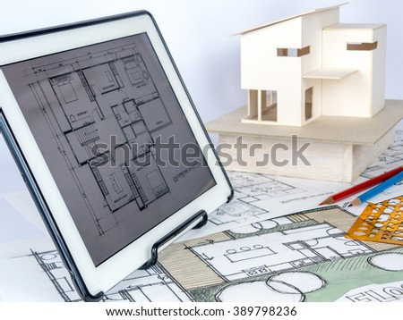 Free photos architects workspace with tablet small house model architects workspace with tablet small house model drawing blueprints home renovation concept malvernweather Images
