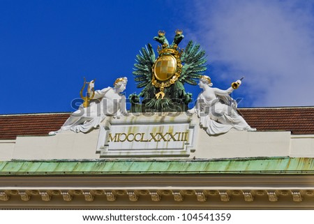 Architectural artistic decorations. Coat of arms at Saint Michael�s wing in Hofburg palace, Vienna; Austria, Europe. Hofburg Palace was residence of Habsburg dynasty, rulers of Austro-Hungarian Empire