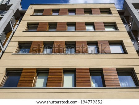 Architectural background of a modern apartment with wooden facade