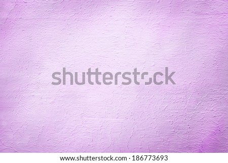 Architectural background of a rough plaster texture with a stippled effect in a pretty shade of lilac or light purple in a 2014 fashion color with light vignetting and copyspace