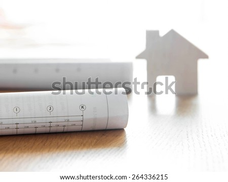 Architectural blueprint for construction over blurred home model
