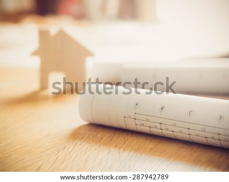 Architectural blueprint of office building over blurred model Home