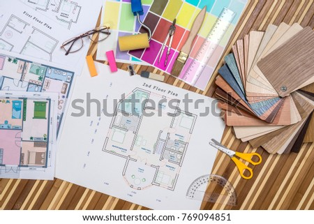 Architectural blueprint with wooden or paper samples and draw tools - Shutterstock ID 769094851