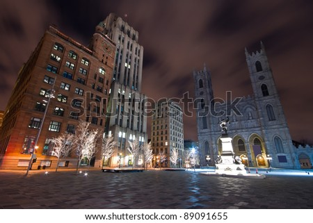 Architectural buildings seen from the Place d'Armes in Old Montreal and Basilica of Notre-Dame ( Night Scene )