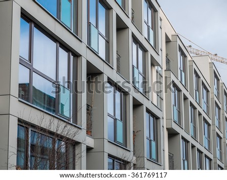 Architectural Close Up Of Residential Building Exterior   Modern Apartment  Building With Large Windows And Small