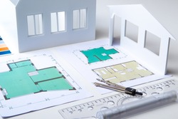 Architectural company. Architect. Office of the architectural bureau. Small copy of the house. Drawings on the architect's desk. Architectural decisions. Work with floor plans. Matching.