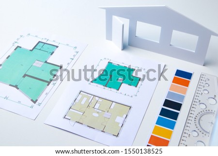 Architectural company. Architect's desk. Design of the building. Floor plan. Architect is working on a building design. Exact copy of the future home. Layout of the rooms. Reconstruction of premises