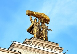 Architectural composition of the Soviet period of the USSR mid-twentieth century with a sculpture of metal glorifying the collective farm system in the USSR