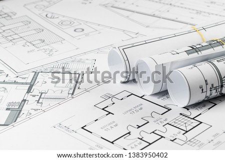 Architectural construction drawings twisted into a roll, construction projects on paper. The concept of architecture, construction, engineering. Copy space. #1383950402