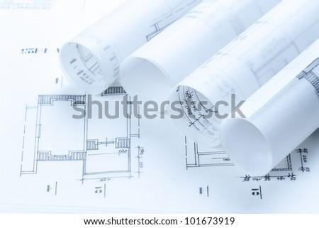 Architectural construction plans toned blue - stock photo