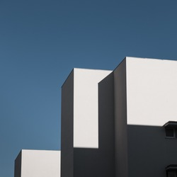 Architectural detail of a modern white building with windows