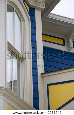 Architectural detail of a Victorian house with nice paint scheme