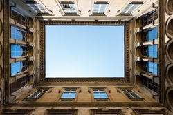 Architectural detail of an open courtyard in an ild building in Budapest, Hungary.
