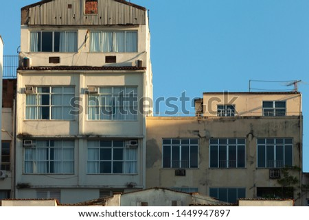 Architectural detail of facades of residential buildings at the Copacabana beach boulevard with weathered exteriors #1449947897