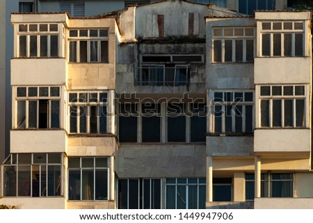 Architectural detail of facades of residential buildings at the Copacabana beach boulevard with weathered exteriors