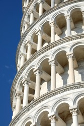 Architectural Detail of Leaning Tower of Pisa with white arches and columns in Tuscany in Italy